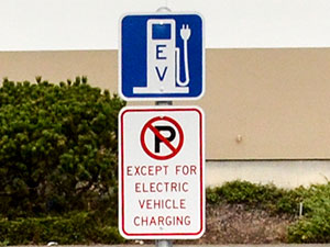 EV symbol sign and no parking sign at a DC quick charging station